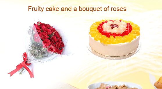Fruity cake and a bouquet of roses